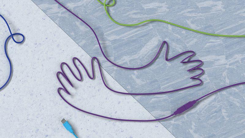 Temabild för tävlingen är elektroniksladdar som formar händer